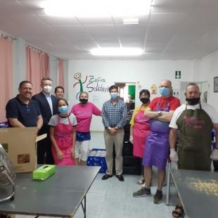 Zafra Solidaria recibe la visita del director regional y los responsables de zona de Mapfre en el comedor social